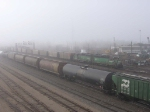 070324016 In dense fog, BNSF Transfer from Daytons Bluff delivers NSPX coal empties to BNSF Grove (Northtown) at CTC 35th
